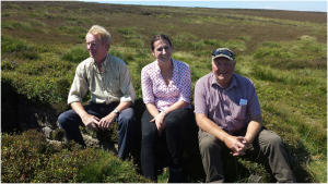 The picture above shows George and Fiona in a sunken grouse butt, designed to blend into the landscape. Photographed below are Moorland Association chairman, Robert Benson, left, with Fiona and Spaunton head keeper George Thompson.